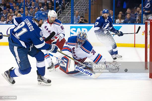 Steven Stamkos of the Tampa Bay Lightning shoots the puck by goalie Henrik Lundqvist of the New York Rangers for a goal during the first period in...