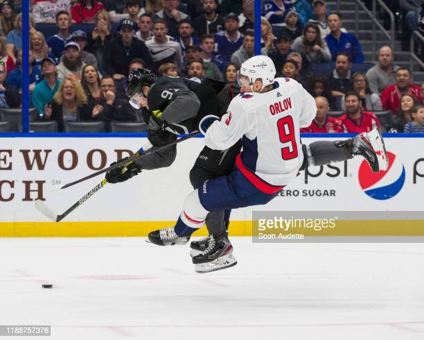 Steven Stamkos of the Tampa Bay Lightning skates against Dmitry Orlov of the Washington Capitals during the first period at Amalie Arena on December...