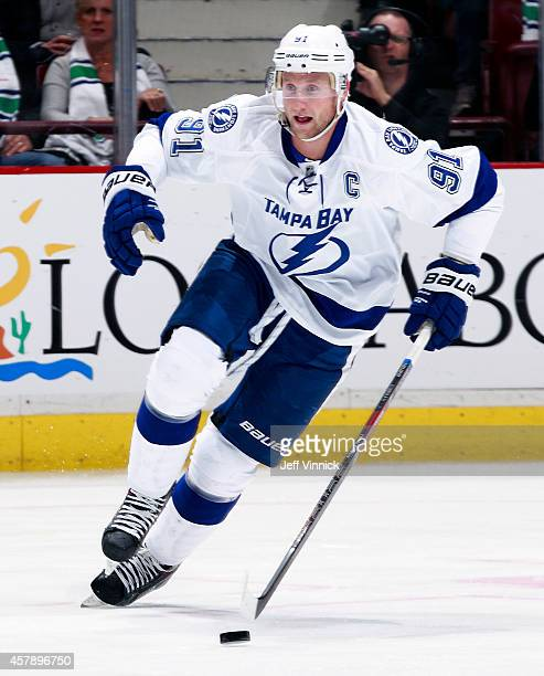 Steven Stamkos of the Tampa Bay Lightning skates up ice with the puck during their NHL game against theVancouver Canucks at Rogers Arena October 18...