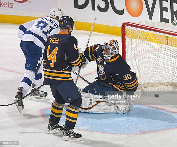 Steven Stamkos of the Tampa Bay Lightning watches his deflection go between the legs of Ryan Miller of the Buffalo Sabres for Tampa Bay's third goal...