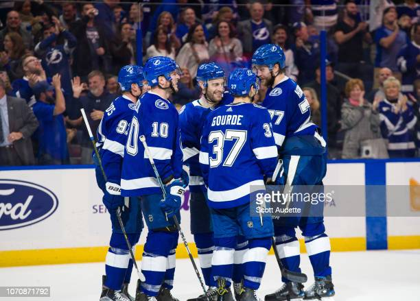 Steven Stamkos Victor Hedman Dan Girardi and Yanni Gourde of the Tampa Bay Lightning celebrate after scoring against the Florida Panthers in the...