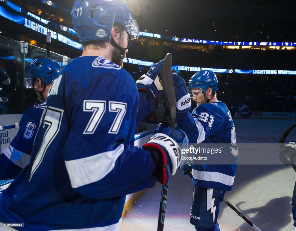 Steven Stamkos #91and Victor Hedman #77 of the Tampa Bay Lightning celebrate the win against the Vancouver Canucks at Amalie Arena on February 8, 2018 in Tampa, Florida.