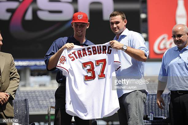 Steven Strasburg and Ryan Zimmerman of the Washington Nationals pose for a photo, before Strasburg is introduced to the media, before a baseball game...