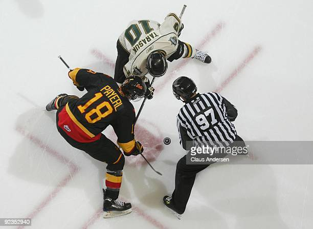 Steven Tarasuk of the London Knights takes a faceoff against Adam Payerl of the Belleville Bulls in a game on October 23 2009 at the John Labatt...