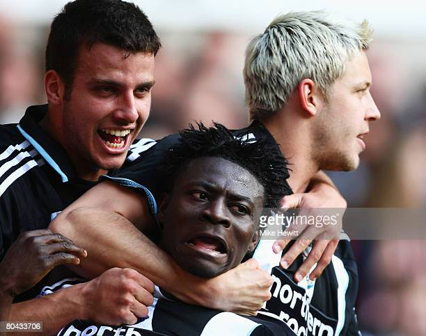 Steven Taylor and Alan Smith celebrate with Obafemi Martins of Newcastle after he scores their 4th goal during the Barclays Premier League match...