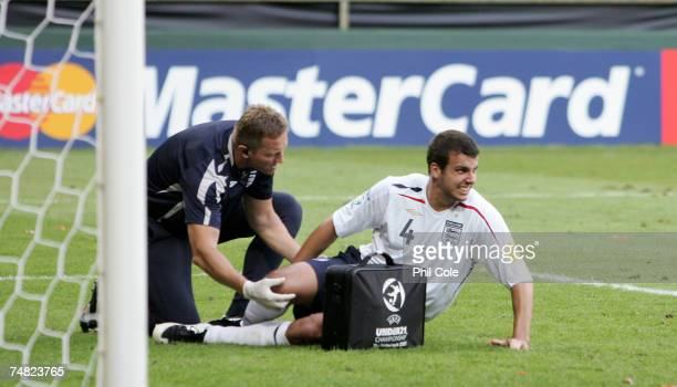 Steven Taylor of England recieves treatment on his ankle during the UEFA European Under21 Championship semifinal match between the Netherlandsl U21...