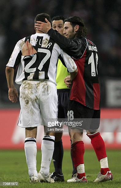 Steven Taylor of Newcastle is seen with scratches on his back next to Ioannis Amanatidis of Frankfurt during the UEFA Cup Group H match between...