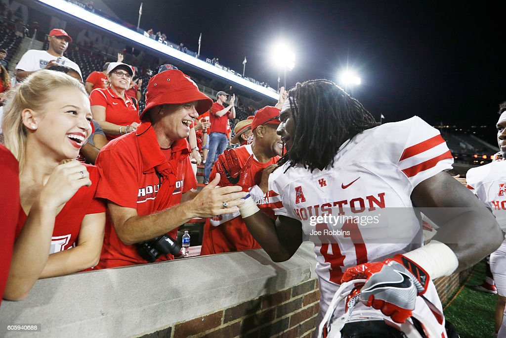 Steven Taylor #41 of the Houston Cougars celebrates with fans after the game against the Cincinnati Bearcats at Nippert Stadium on September 15, 2016 in Cincinnati, Ohio. Houston defeated Cincinnati 40-16.
