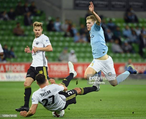 Steven Taylor of the Phoenix and Riley McGree of the Melbourne City compete for the ball during the round four ALeague match between Melbourne City...