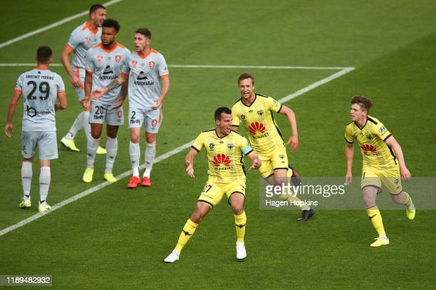 Steven Taylor of the Phoenix celebrates with Matti Steinmann and Callum McCowatt after scoring a goal during the round seven A-League match between...