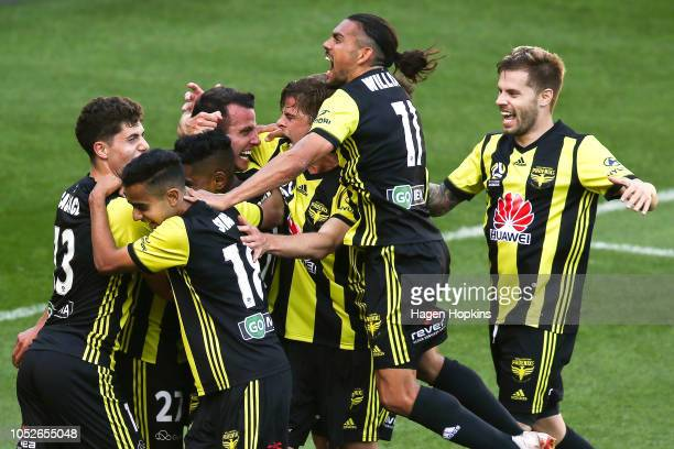 Steven Taylor of the Phoenix celebrates with teammates after scoring a goal during the round one ALeague match between the Wellington Phoenix and the...