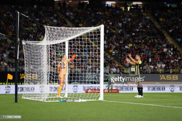 Steven Taylor of the Phoenix tries to obstruct the view of goal keeper Lawrence Thomas of the Victory during a free kick during the ALeague match...