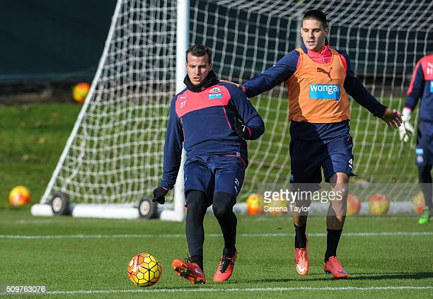 Steven Taylor passes the ball whilst Aleksandar Mitrovic looks to close down during the Newcastle United Training session at The Newcastle United...
