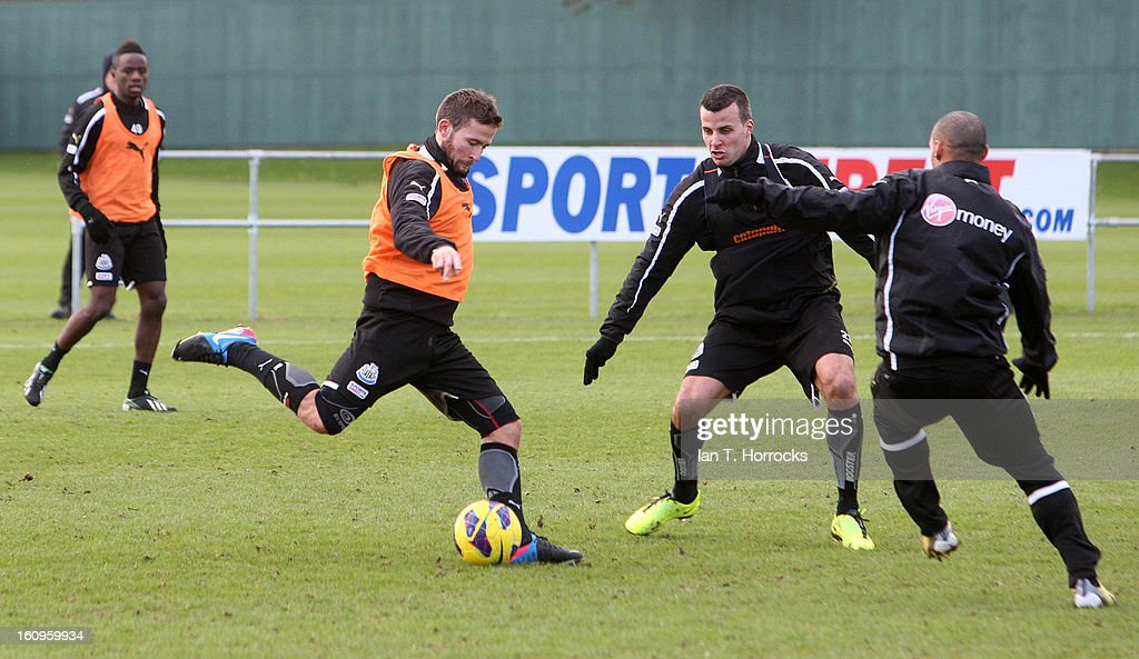 Steven Taylor (2R) tries to stop a Yohan Cabaye shot during a Newcastle United training session at the Little Benton training ground on February 08, 2013 in Newcastle upon Tyne, England.