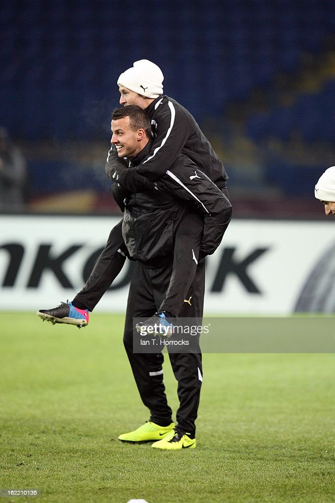 Steven Taylor with Yohan Cabaye of Newcastle United FC piggy backing while they attend a training session ahead of their UEFA Europa League round of 32 second leg match against FC Metalist Kharkiv, at Metalist Stadium, on February 20, 2013 in Kharkov, Ukraine.