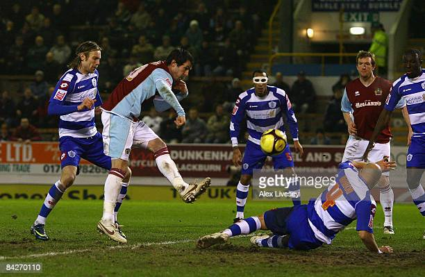 Steven Thompson of Burnley scores the equalizing goal against Queens Park Rangers during the FA Cup Third Round Replay match sponsored by eon between...