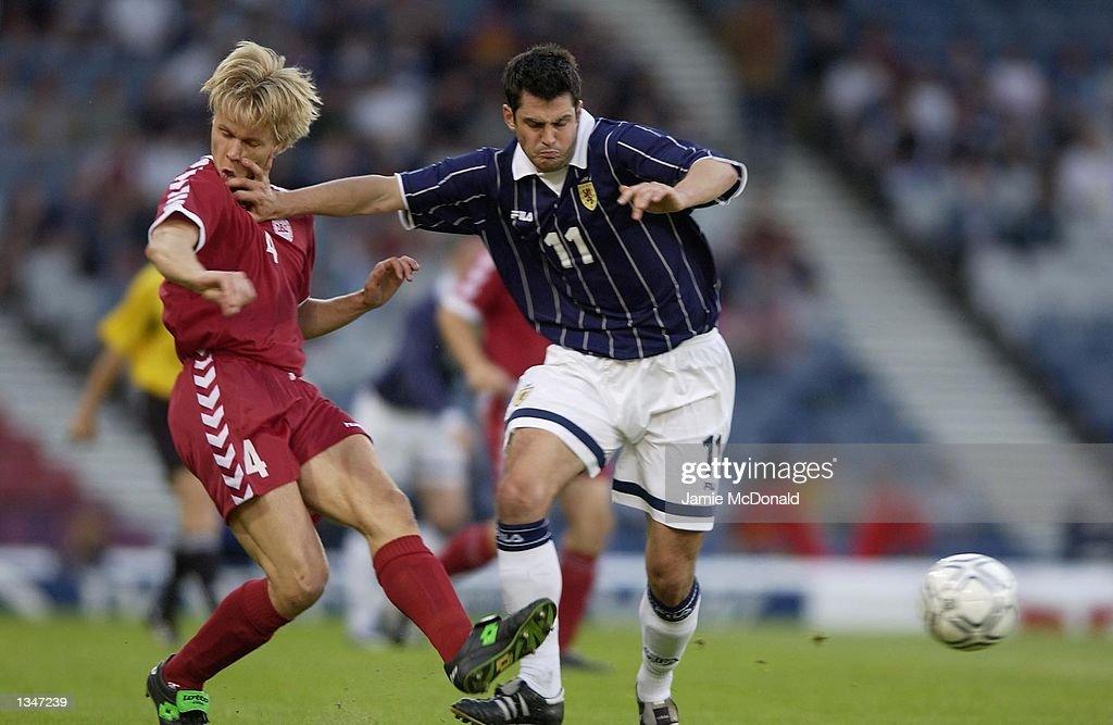 Steven Thompson of Scotland holds off Martin Laursen of Denmark during the Safeway International Challenge match between Scotland and Denmark at Hampden Park, Glasgow, Scotland on August 21, 2002.