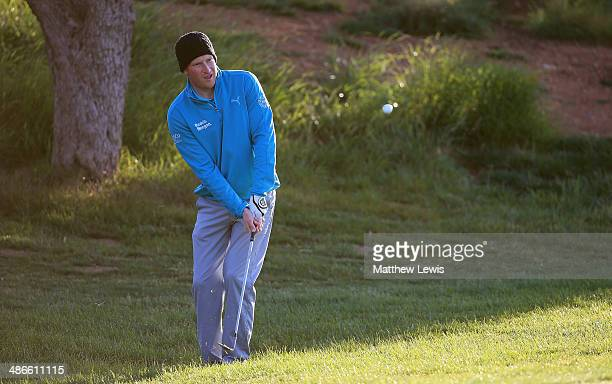 Steven Tiley of England chips onto the 1st green during day two of the Challenge de Catalunya at the Lumine Golf and Beach Club on April 25 2014 in...