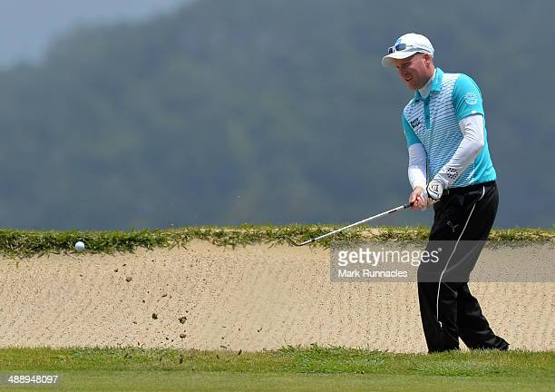 Steven Tiley of England plays a bunker shot from the back of the 4th green during the Madeira Islands Open Portugal BPI at Club de Golf do Santo da...