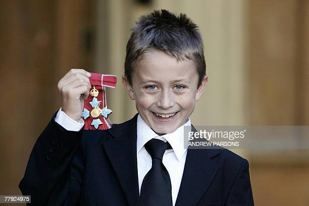Steven Tomlinson son of the late cancer sufferer Jane Tomlinson poses for pictures after receiving her Commander of the Most Excellent Order of the...