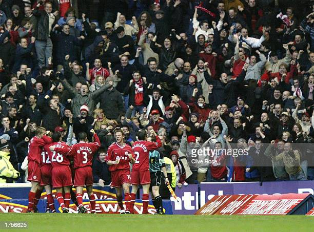 Steven Tosh of Aberdeen and his teammates celebrate in front of the Aberdeen fans during the Bank of Scotland Premier League match between Glasgow...