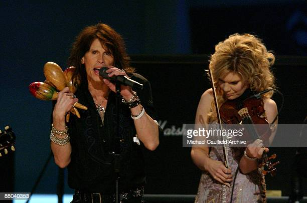 Steven Tyler and Alison Krauss perform Across The Universe for the Tsunami Relief performance Photo by M Caulfield/WireImage for The Recording Academy