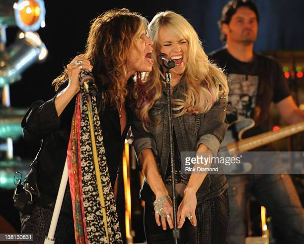 Steven Tyler and Carrie Underwood perform at the CMT Crossroads Live From Pepsi Super Bowl Fan Jam rehearsals at Indiana State Fairgrounds Pepsi...