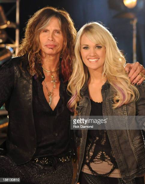 Steven Tyler and Carrie Underwood pose at the CMT Crossroads Live From Pepsi Super Bowl Fan Jam rehearsals at Indiana State Fairgrounds Pepsi...