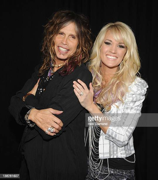 Steven Tyler and Carrie Underwood pose backstage at the CMT Crossroads Live From Pepsi Super Bowl Fan Jam at Indiana State Fairgrounds Pepsi Coliseum...
