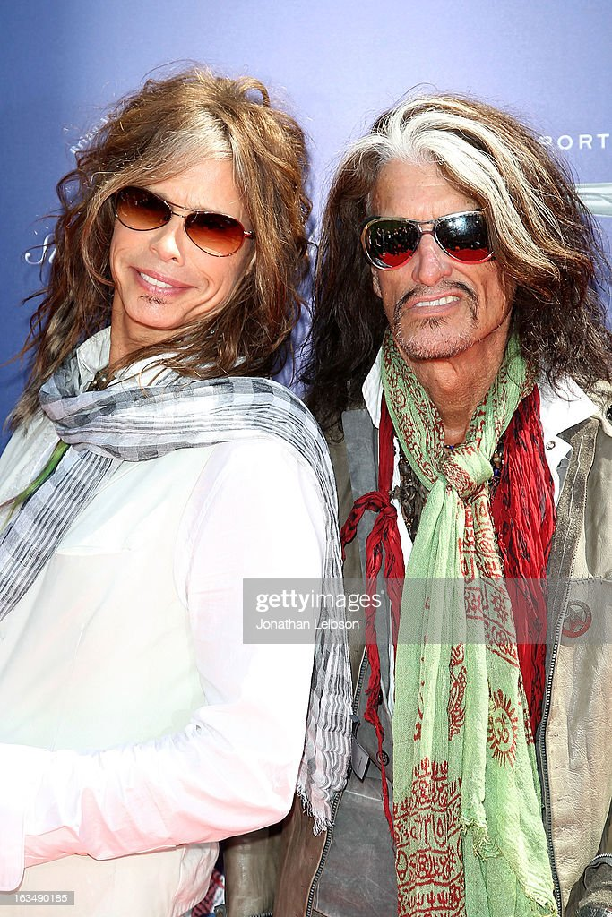 Steven Tyler and Joe Perry attend the John Varvatos 10th Annual Stuart House Benefit at John Varvatos Los Angeles on March 10, 2013 in Los Angeles, California.