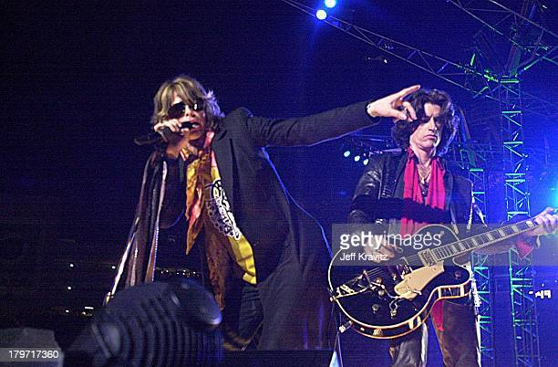 Steven Tyler and Joe Perry of Aerosmith during Super Bowl XXXV Halftime Show 2001 at Raymond James Stadium in Tampa FL United States