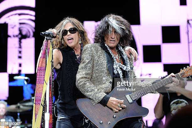 """Steven Tyler and Joe Perry of Aerosmith perform during the opening night of the """"Global Warming Tour"""" at the Target Center on June 16, 2012 in..."""