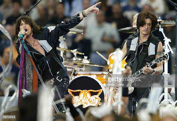 Steven Tyler and Joe Perry of Aerosmith perform during the pregame show prior to the start of Super Bowl XXXVIII between the New England Patriots and...