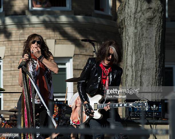 Steven Tyler and Joe Perry of Aerosmith performing in front of 1325 Commonwealth Avenue in Boston MA on November 3 the building where the band lived...