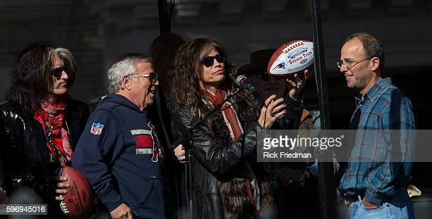 Steven Tyler and Joe Perry of Aerosmith with New England Patriots owner Robert Kraft © and Jonathon Kraft ® in front of 1325 Commonwealth Avenue in...