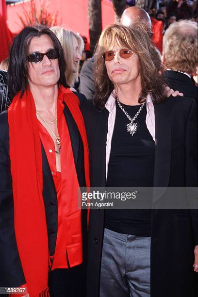 Steven Tyler and Joe Perry of the rock band Aerosmith arrive at the Oscar Awards in Los Angeles CA The group was one of the most popular hard rock...