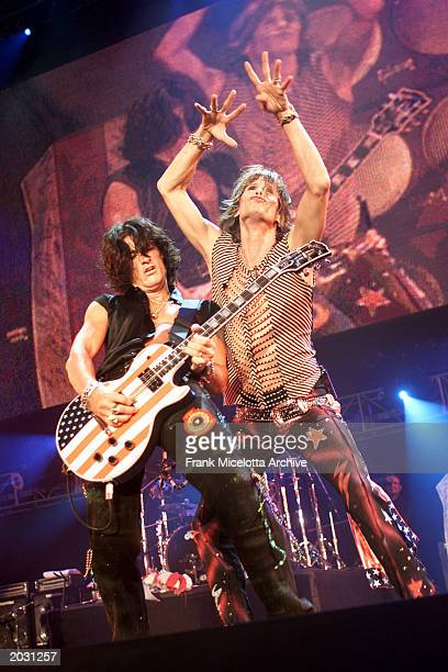 Steven Tyler and Joe Perry of the rock band Aerosmith perform at the 'United We Stand What More Can I Give Concert' to benefit the recovery efforts...