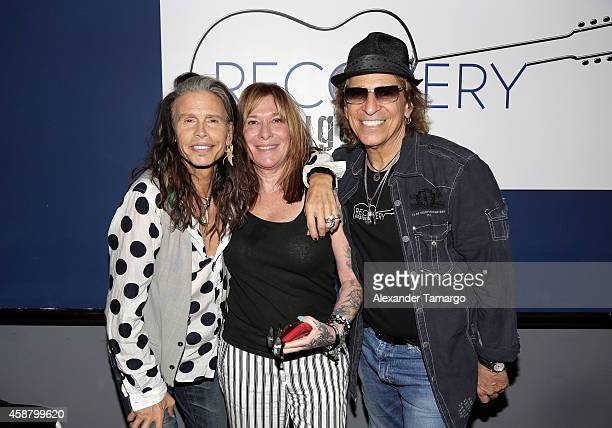 Steven Tyler and Richie Supa pose with a guest at Recovery Unplugged where Steven Tyler performed and spoke with clients of Recovery Unplugged...