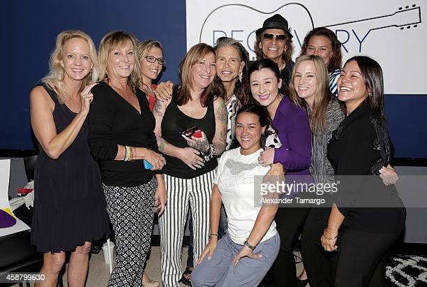Steven Tyler and Richie Supa pose with guests at Recovery Unplugged where Steven Tyler performed and spoke with clients of Recovery Unplugged...