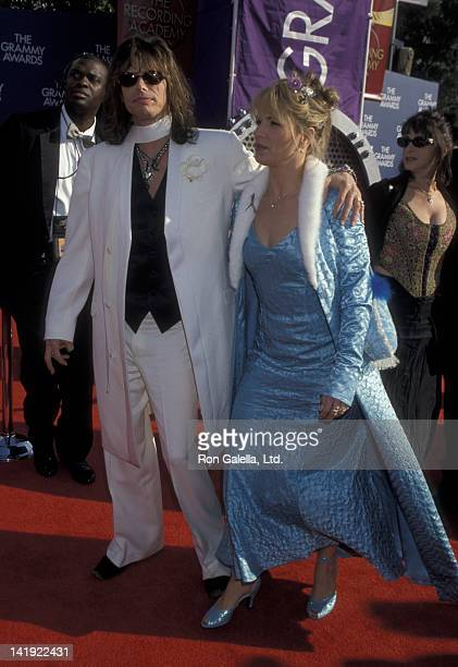 Steven Tyler and wife Teresa Barrick attend 41st Annual Grammy Awards on February 24 1999 at the Shrine Auditorium in Los Angeles California