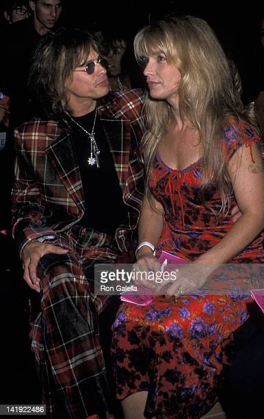 Steven Tyler and wife Teresa Barrick attend Betsey Johnson Spring Collection Fashion Show on September 19 2000 at Bryant Park in New York City