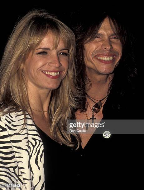 Steven Tyler and wife Teresa Barrick attend the grand opening of Versace Boutique on October 26 1996 in New York City