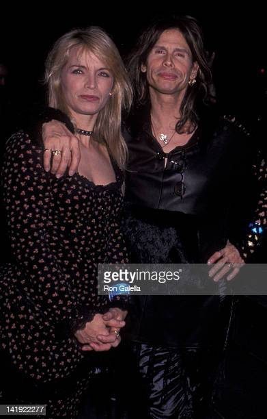 Steven Tyler and wife Teresa Barrick attend the grand opening of Christian Dior Boutique on December 4 1999 in New York City