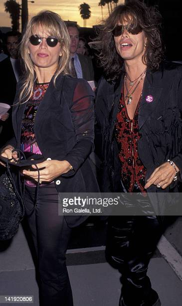 Steven Tyler and wife Teresa Barrick attend the premiere of Stealing Beauty on June 19 1996 at AMC Fine Arts Theater in Beverly Hills California