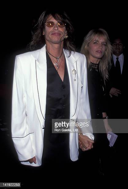 Steven Tyler and wife Teresa Barrick attend Versace Fashion Show on September 12 1999 at Roseland in New York City
