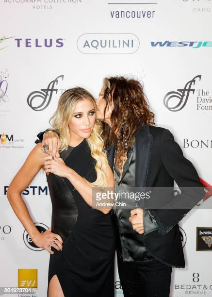 Steven Tyler kisses Aimee Preston during the David Foster Foundation Gala at Rogers Arena on October 21 2017 in Vancouver Canada