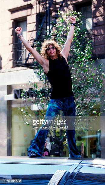 Steven Tyler, lead singer of Aerosmith, rock band, stood on top of his limousine in midtown Manhattan on September 20, 2000 in NYC. He was in town...