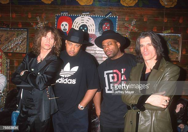 Steven Tyler of Aerosmith Joseph 'DJ Run' Simmons Jason 'Jam Master Jay' Mizell and Joe Perry of Aerosmith backstage at HOB