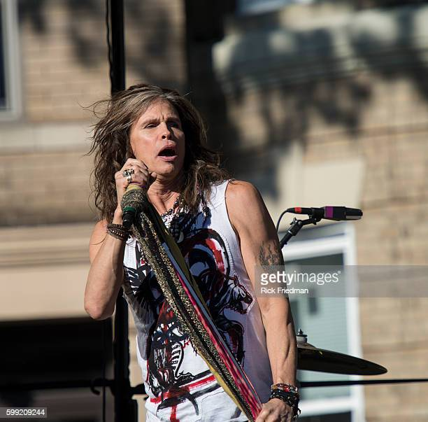 Steven Tyler of Aerosmith performing in front of 1325 Commonwealth Avenue in Boston MA on November 3 the building where the band lived when the band...