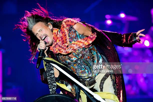 TOPSHOT Steven Tyler of Aerosmith performs at the Royal Arena in Copenhagen on June 5 2017 / AFP PHOTO / Scanpix / Nils Meilvang / Denmark OUT
